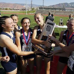 Millard runners celebrate first place in the 2A girls high school state cross-country championship in Cedar City on Wednesday, Oct. 21, 2020.