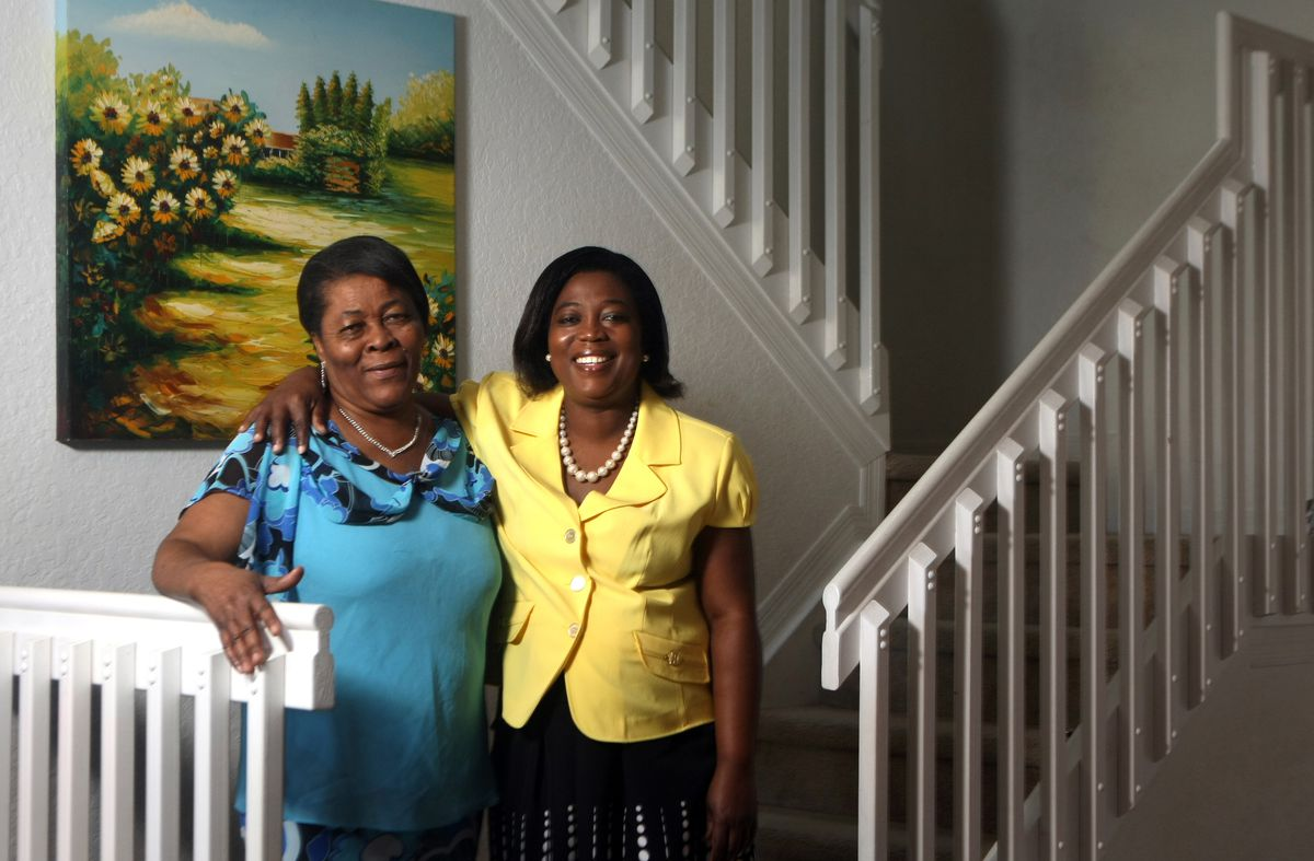 Suze Lubin (right) is a Haitian who benefited from the TPS program and moved to Florida.