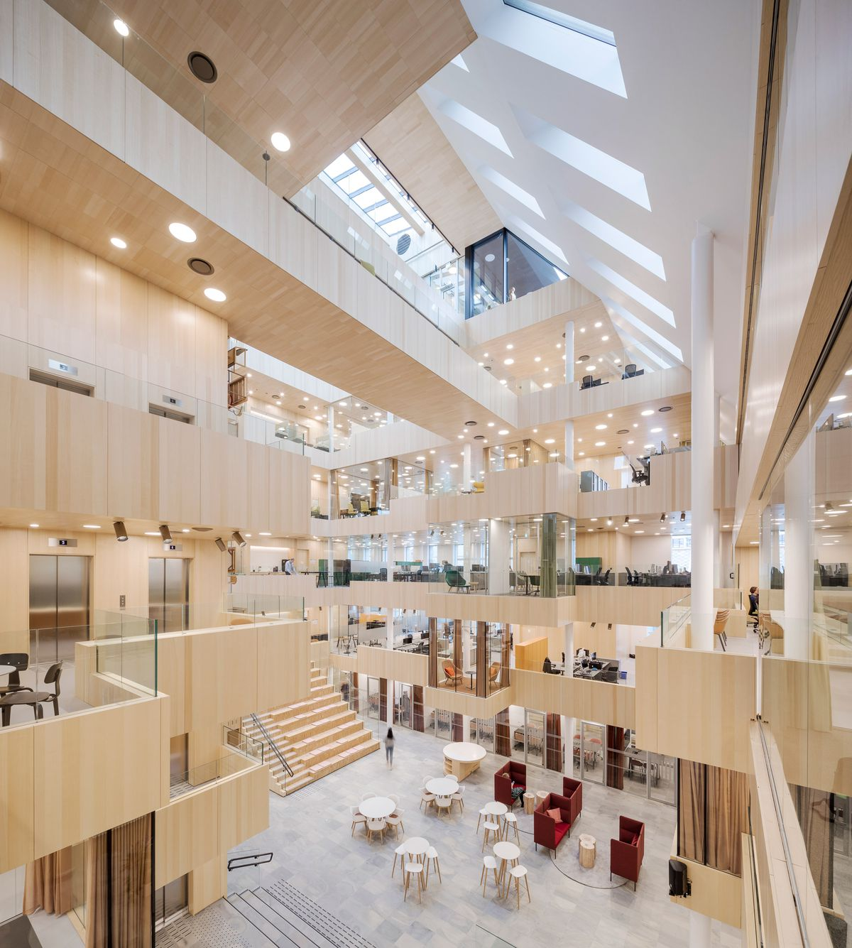 Central atrium wrapped in light ash wood