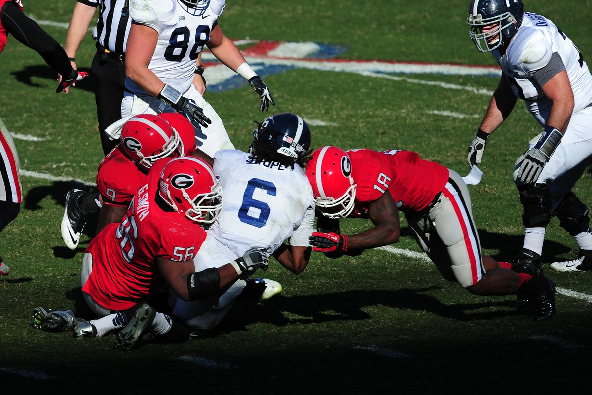 Three tacklers combining to bring down the ballcarrier? That's my idea of the triple option!