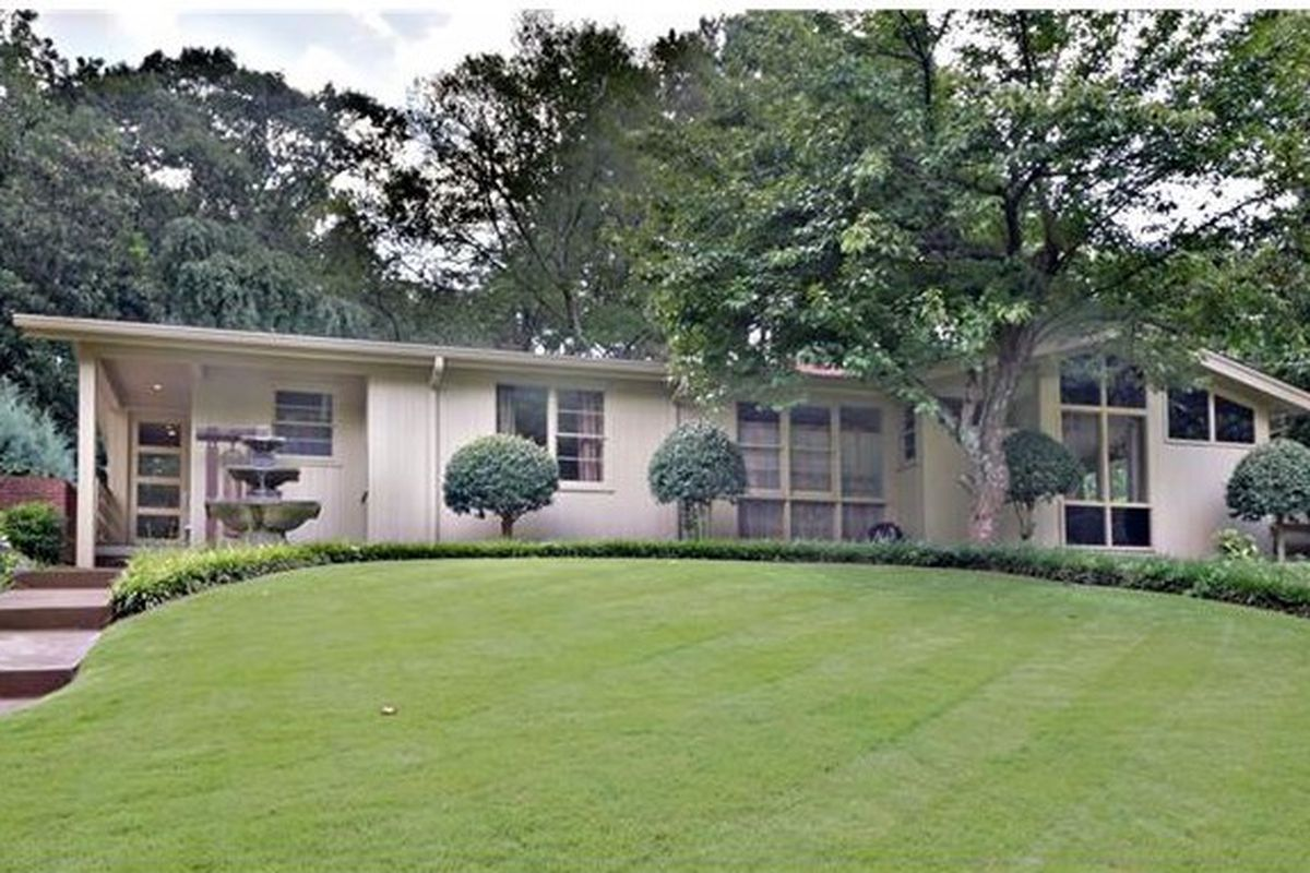 A midcentury modern home for sale in Midtown's Sherwood Forest neighborhood.