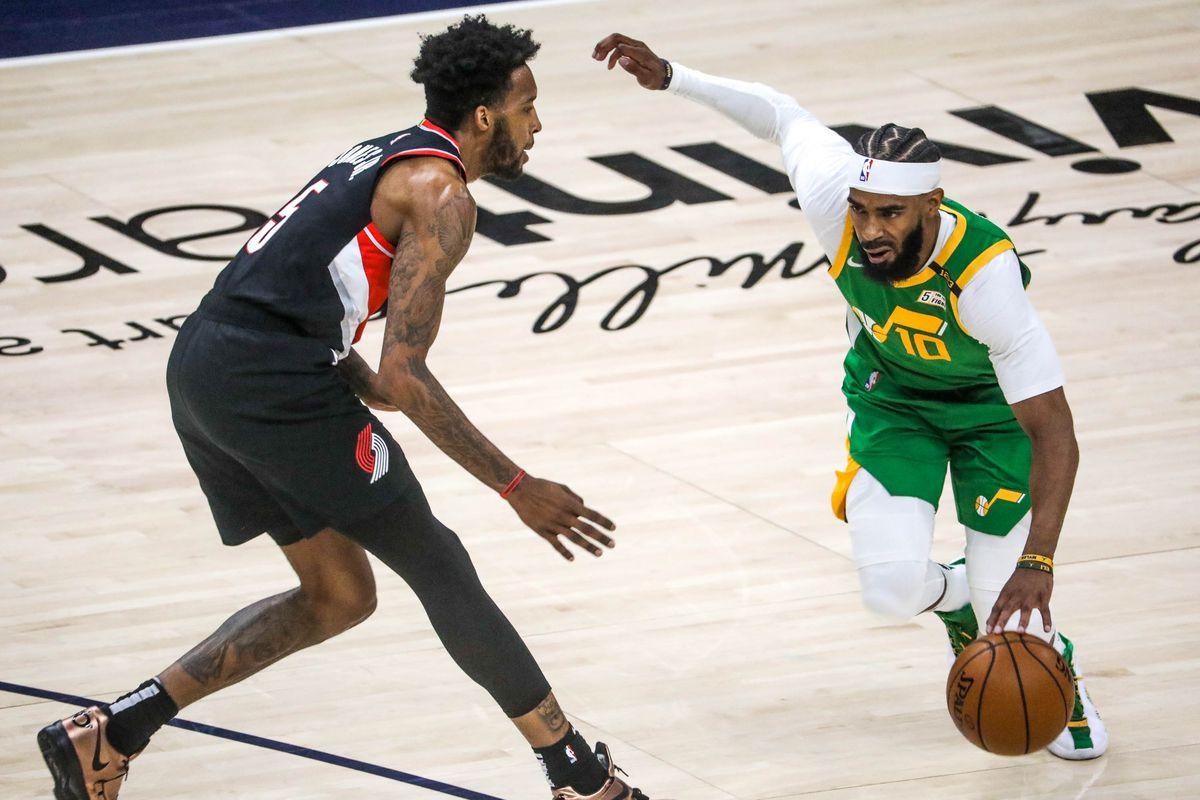 Utah Jazz guard Mike Conley (10) moves past Portland Trail Blazer forward Derrick Jones Jr. (5) during the game at Vivint Smart Home Arena in Salt Lake City on Thursday, April 8, 2021.