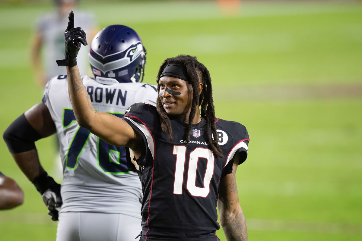Cardinals wide receiver Deandre Hopkins (10) motions against the Seattle Seahawks in the fourth quarter at State Farm Stadium.