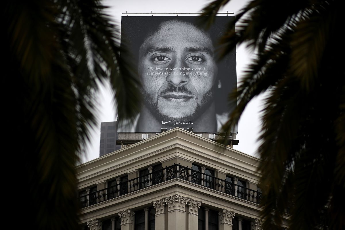 A billboard of Colin Kaepernick's new Nike ad is displayed on the roof of the Nike Store on September 5, 2018, in San Francisco.