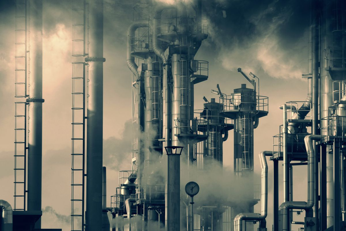 Tall smokestacks in an oil refinery.