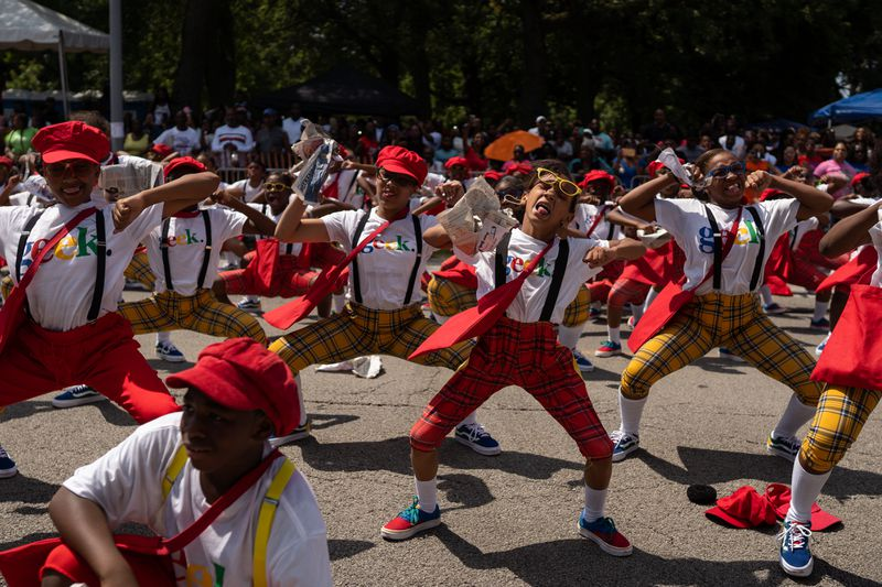 Geeksquad members dance during the 90th Bud Billiken Parade in Bronzeville on August 10, 2019.