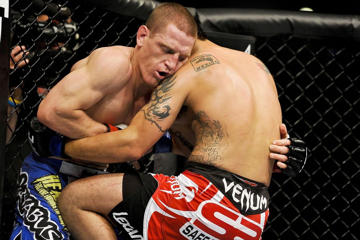 Apr 21, 2012; Atlanta, GA, USA; Mac Danzig (left) fights Efrain Escudero in a lightweight bout during UFC 145 at Philips Arena. Mac Danzig won by unanimous decision. Mandatory Credit: Paul Abell-US PRESSWIRE
