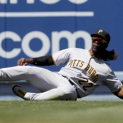 Pittsburgh Pirates center fielder Andrew McCutchen can't hang one to a ball  hit by Los Angeles Dodgers' Juan Uribe during the second inning of a baseball game in Los Angeles, Tuesday, April 10, 2012. Uribe was credited with a single on the play.