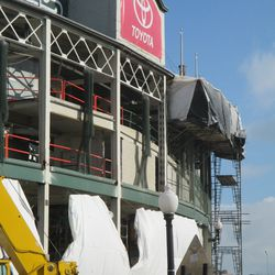 11:51 a.m. View of the enclosed scaffolding, along the top of the Addison Street side of the front of the ballpark -