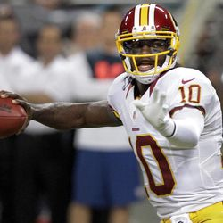 Washington Redskins quarterback Robert Griffin III throws during the first quarter of an NFL football game against the St. Louis Rams, Sunday, Sept. 16, 2012, in St. Louis.