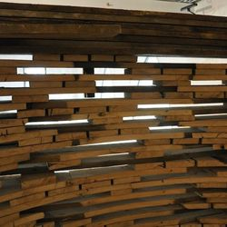 The entrance element made from wood reclaimed from a 100-year old barn in Missouri.