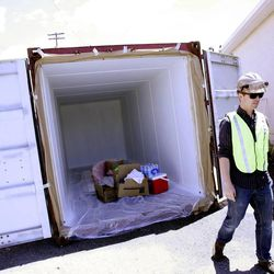 James Alfandre walks past one of the shipping containers that will line the middle of 700 South near 300 West in the Granary District of Salt Lake City on Thursday, May 30, 2013. Starting mid-June, the street will become a festival site Thursday and Friday evenings and Saturdays through the summer. Shipping containers will line the center of the street where local artisans and entrepreneurs will sell their work. Live music, food and a beer garden will also be part of the festival. Jewelry designers, artists, clothing designers, a bicycle shop and a cupcake maker will occupy the shipping containers.