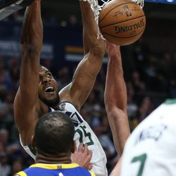 Utah Jazz forward Derrick Favors (15) dunks during the game against the Golden State Warriors at Vivint Arena in Salt Lake City on Tuesday, April 10, 2018.