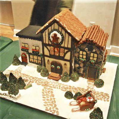 Gingerbread house with a pebble-like road outside.
