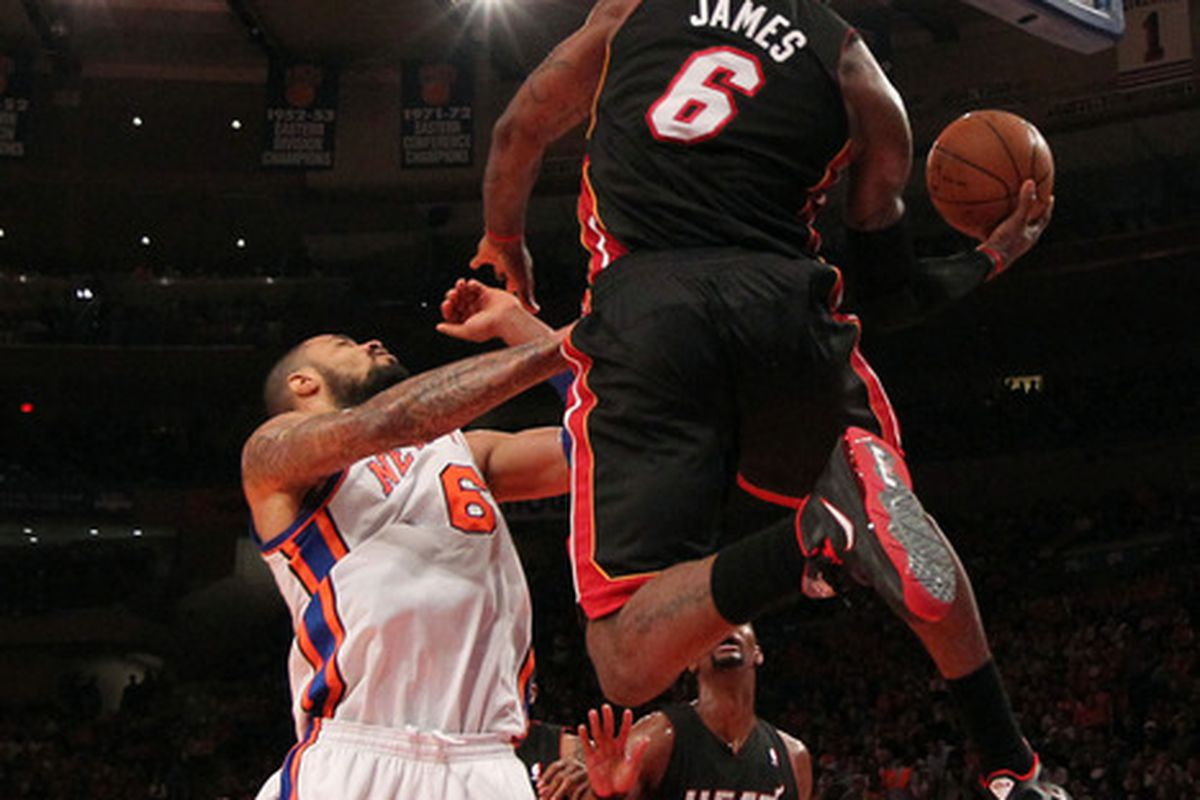 Apr 15, 2012; New York, NY, USA;  Miami Heat small forward LeBron James (6) scores from under the basket during the second quarter against the New York Knicks at Madison Square Garden.  Mandatory Credit: Anthony Gruppuso-US PRESSWIRE