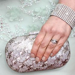 Here's a closeup of her clutch, bracelet and understated mani.