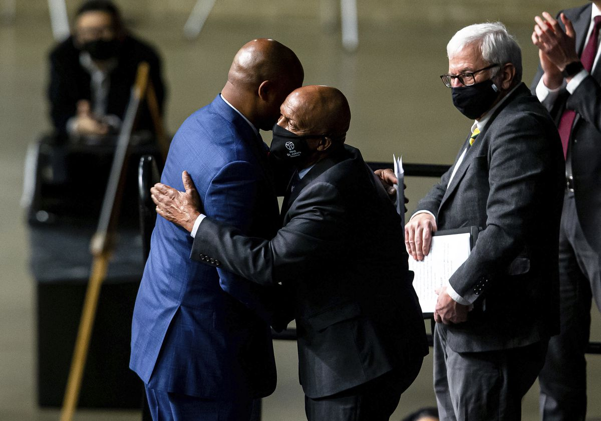 """House Emanuel """"Chris"""" Welch, D-Hillside, gets a hug from Illinois Secretary of State Jesse White after taking the Oath of Office at the Bank of Springfield Center on Wednesday."""