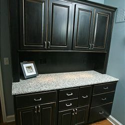 Sarah Soden has EnviroGLAS, a countertop material made from chips of recycled glass, on an antique hutch/sideboard in her kitchen.