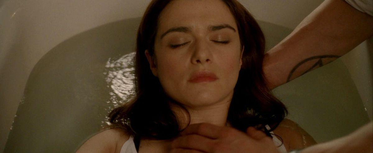 constantine lays angela under water in a bathtub