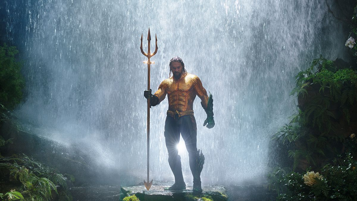 Aquaman - Aquaman standing in front of a waterfall holding his trident