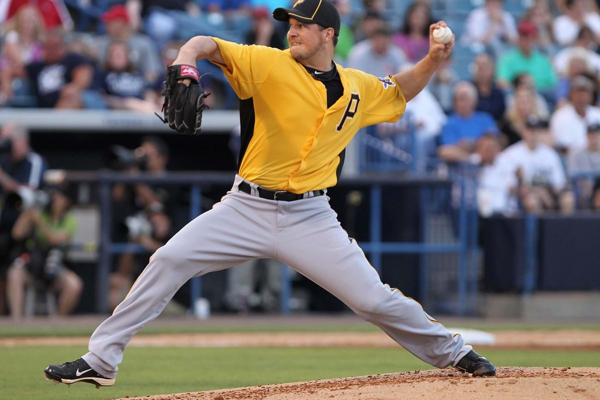 March 20, 2012; Tampa, FL, USA; Pittsburgh Pirates starting pitcher Erik Bedard (45) throws a pitch in the first inning against the New York Yankees at George M. Steinbrenner Field. Mandatory Credit: Kim Klement-US PRESSWIRE
