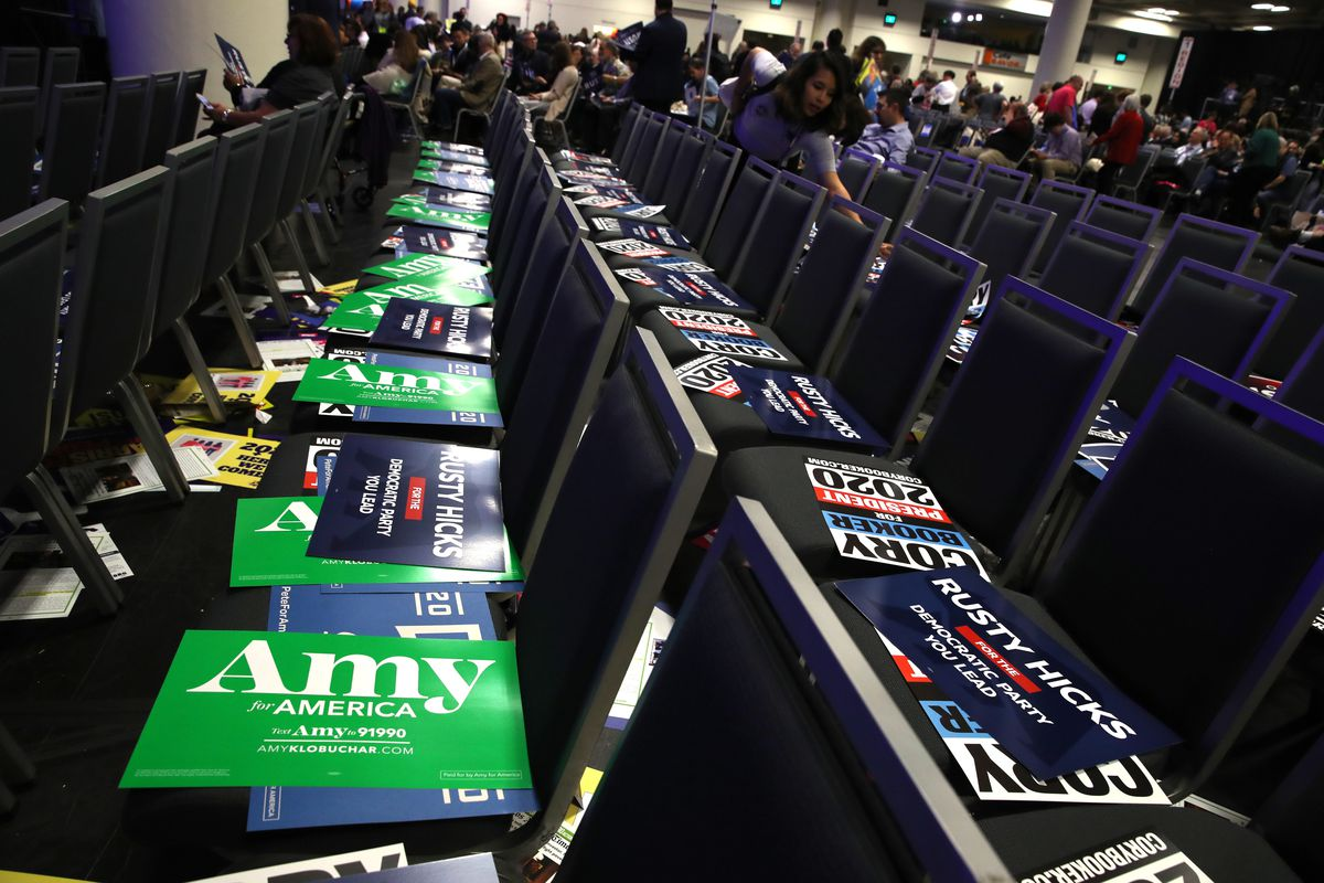 Chairs in an auditorium with Democratic presidential campaign signs on each seat.