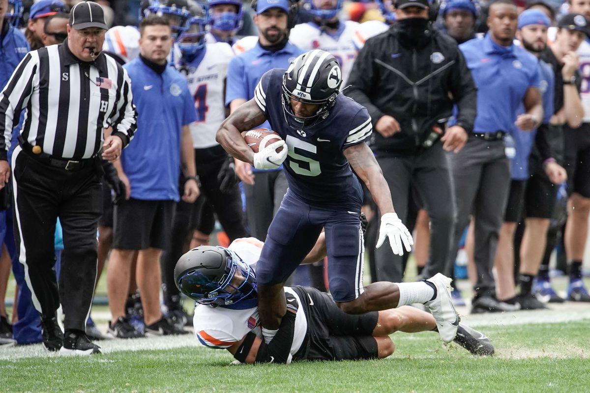 BYU wide receiver Chris Jackson (5) gets tackled by Boise State cornerback Kaonohi Kaniho.