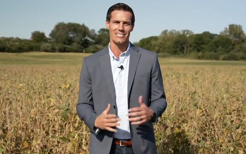 Republican Jesse Sullivan stands in soy bean field outside his own in Petersburg, Ill.