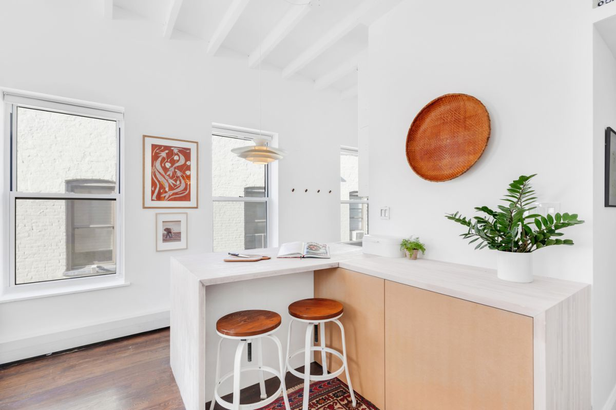 A kitchen island with two stools.