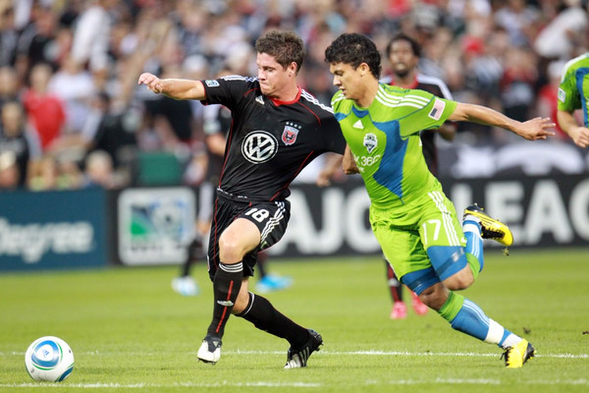 WASHINGTON - JULY 15: Devon McTavish #18 of D.C. United controls the ball against Fredy Montero #17 of Seattle Sounders FC at RFK Stadium on July 15 2010 in Washington DC. (Photo by Ned Dishman/Getty Images)