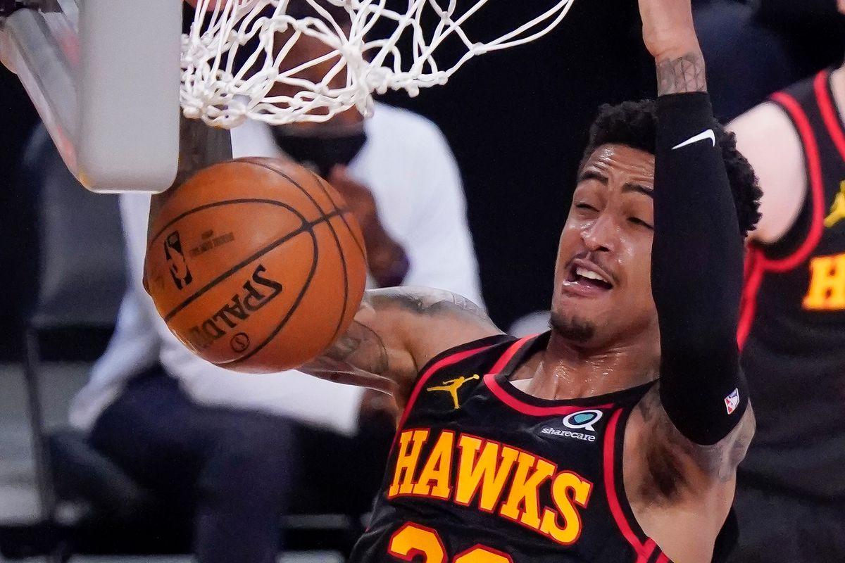 Atlanta Hawks forward John Collins slam dunks during the fourth quarter against the Los Angeles Lakers at Staples Center.