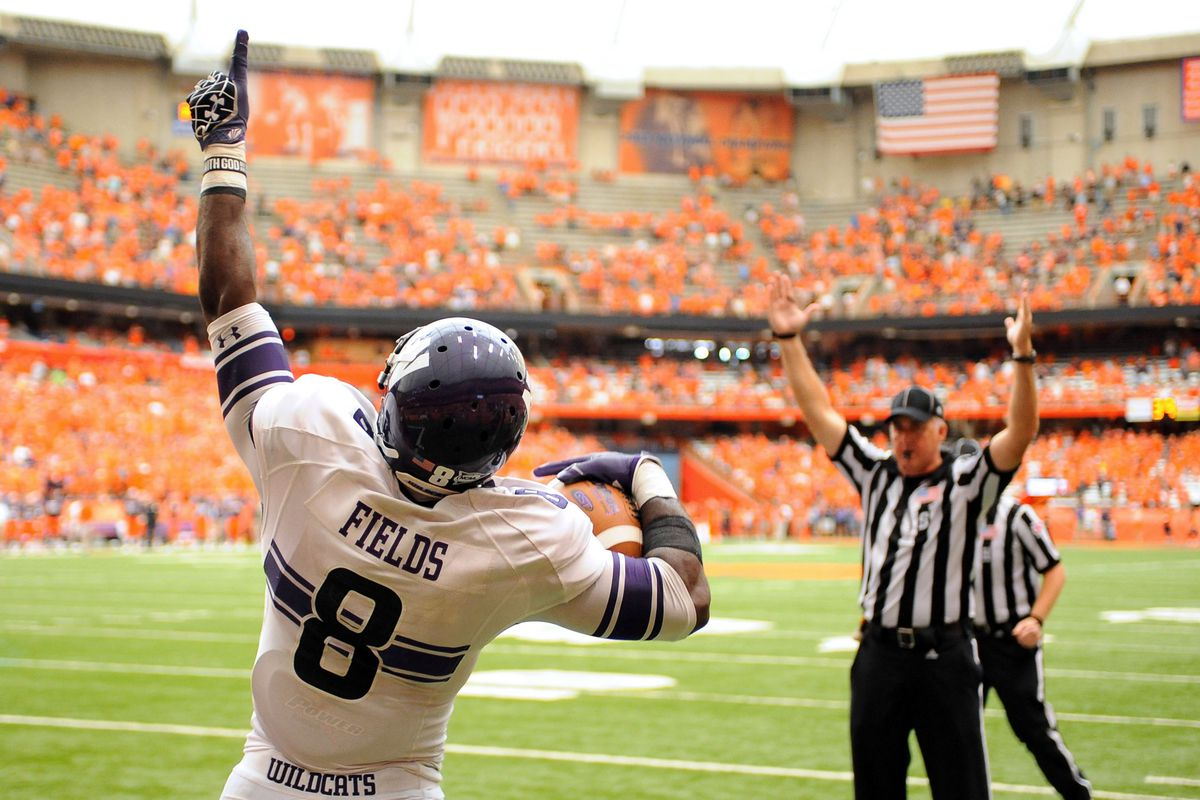 Sep 1, 2012; Syracuse, NY, USA; Northwestern Wildcats wide receiver Demetrius Fields (8) reacts after scoring a touchdown in the fourth quarter against the Syracuse Orange at the Carrier Dome. Mandatory Credit: Rich Barnes-US PRESSWIRE