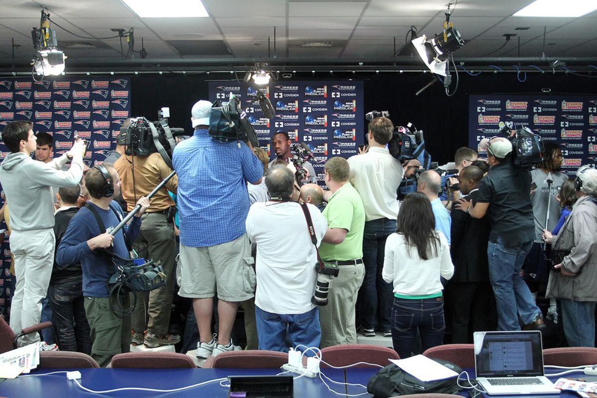 May 11, 2012; Foxborough, MA, USA; The media surround New England Patriots first round draft choice Chandler Jones (center) prior to a rookie mini camp at Gillette Stadium. Mandatory Credit: Stew Milne-US PRESSWIRE