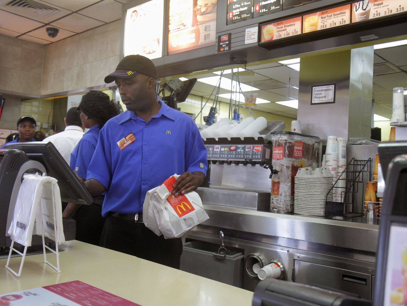 Workers in a Miami McDonald's before the Covid-19 pandemic.