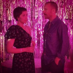 "Maggie and husband Peter Skaarsgard chat. Photo via <a href=""http://instagram.com/p/X6LBVvkOQh/"">mallaryanna</a>/Instagram."