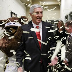 The Jazz Bear greets Jerry Sloan with confetti before the Utah Sports Hall of Fame 2011 induction banquet in Salt Lake City Nov. 16, 2011.