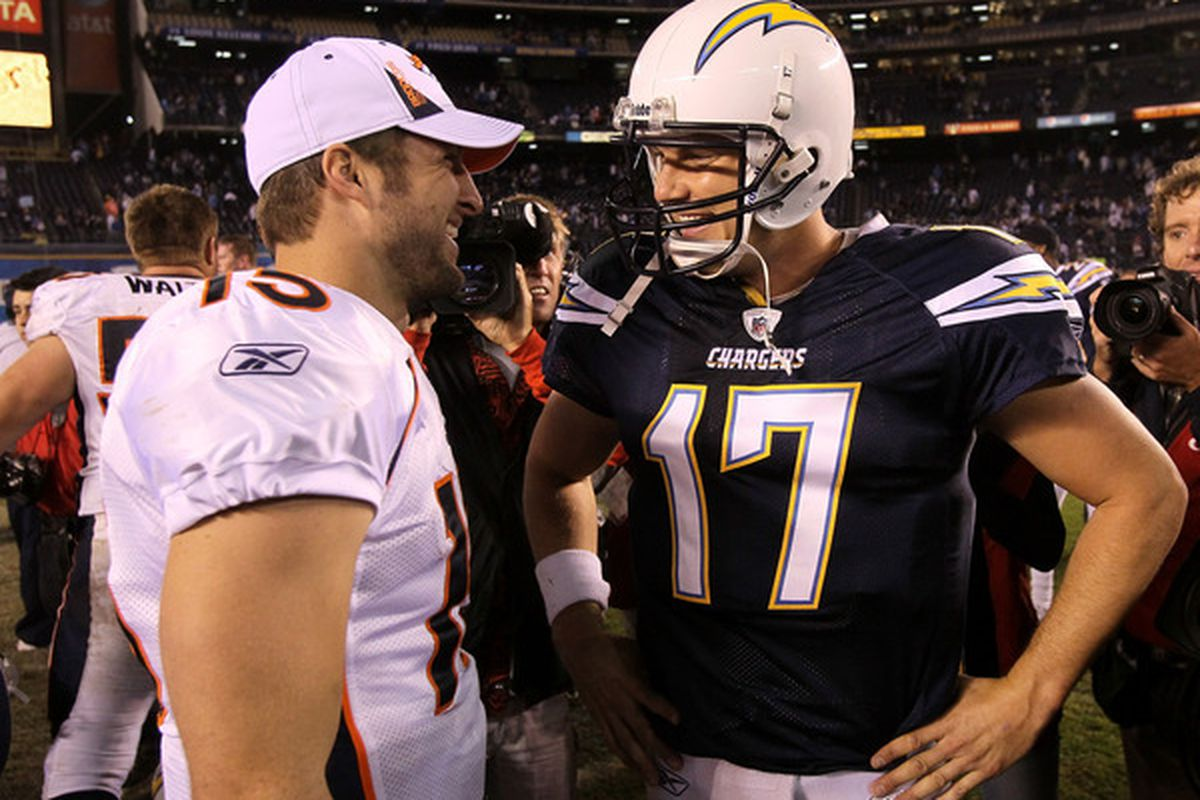Quarterback Philip Rivers #17 of the San Diego Chargers and quarterback Tim Tebow #15 of the Denver Broncos talk after the game.  (Photo by Stephen Dunn/Getty Images)