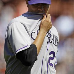 Colorado Rockies starting pitcher Jorge De La Rosa walks to the dugout after being taken out in the fourth inning of a baseball game against the San Francisco Giants in San Francisco, Thursday, Sept. 20, 2012.