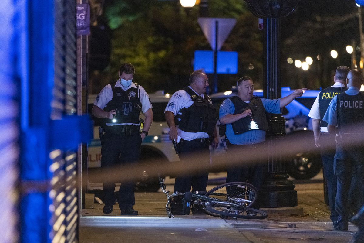 Chicago police work the scene where at least 6 people were shot in the 2000 block of East 71st Street in the South Shore neighborhood, Sunday, June 27, 2021.