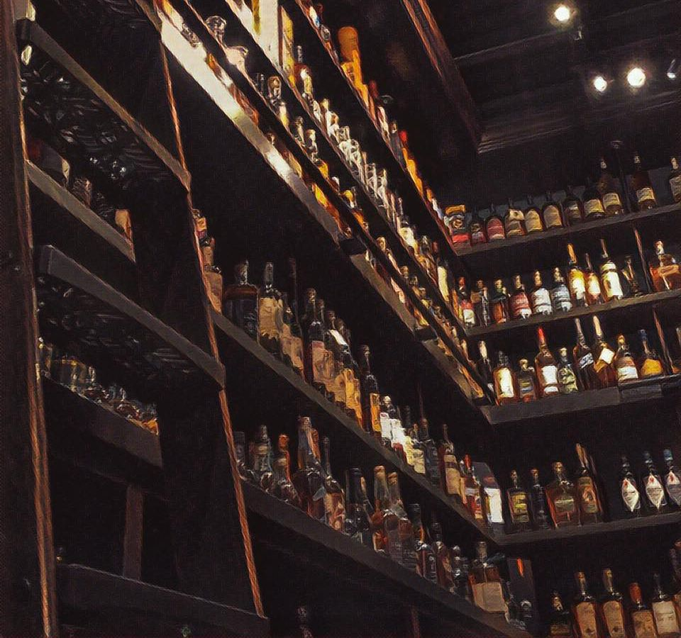 Inside a dark liquor store with shelves and shelves of whiskey, like a library. An old wooden ladder is secured to the shelves.
