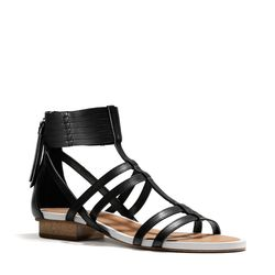 "<a href=""http://f.curbed.cc/f/Coach_031014_NillieSandal"">Nillie Sandal in Black</a>, $278"