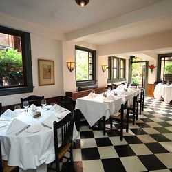 Tabard Inn's checkerboard floors are just about as classic as the freshly made doughnuts people clamor over at brunch. Look out over the garden from this sunny dining room, or wind your way through the restaurant to other more secluded spots. [Photo: <a h