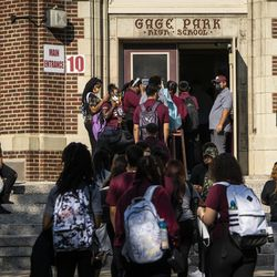 Students arrive at Gage Park High School, 5630 S. Rockwell St. in Gage Park, for the first day of school.
