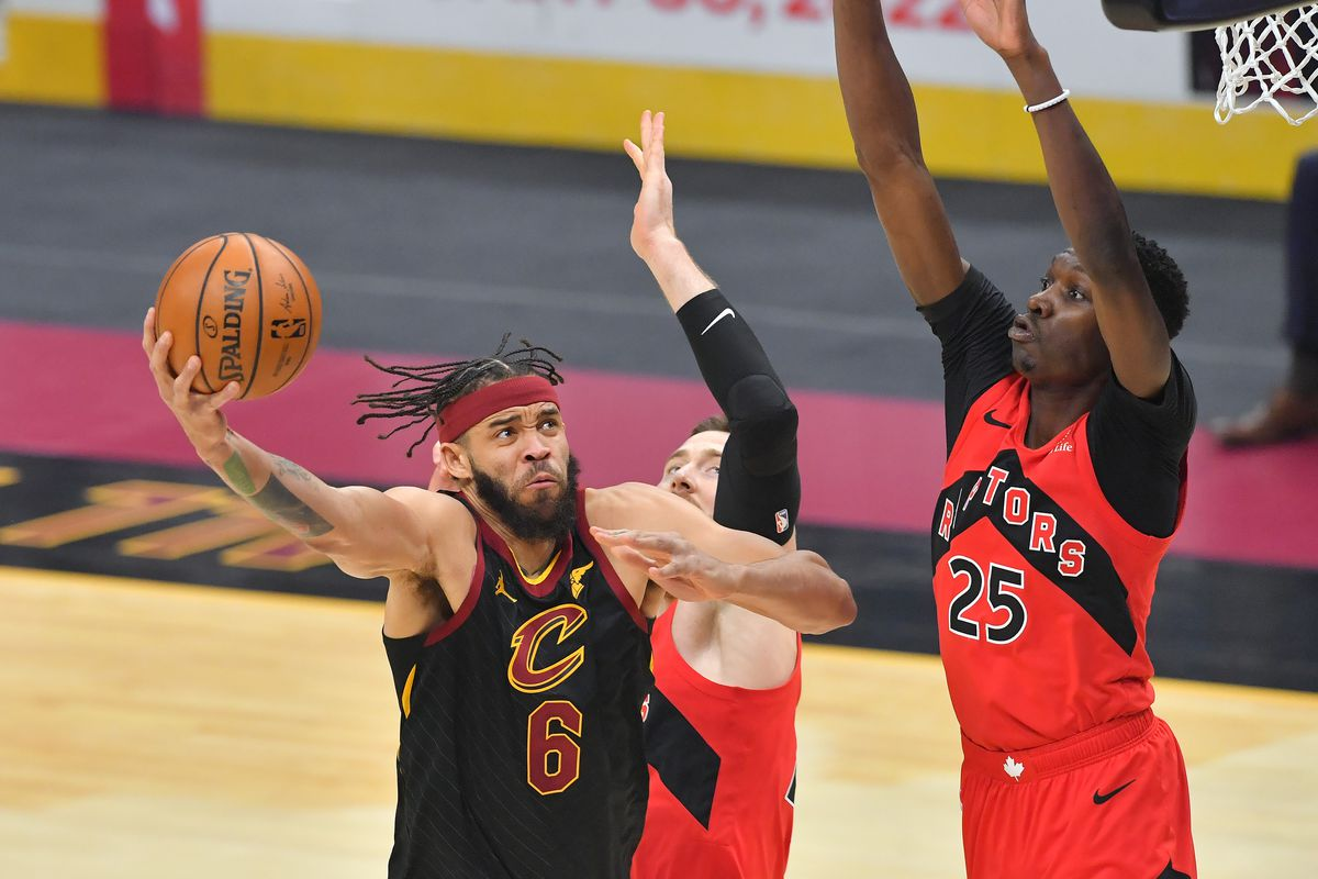 JaVale McGee of the Cleveland Cavaliers shoots over Chris Boucher of the Toronto Raptors during the first quarter at Rocket Mortgage Fieldhouse on March 21, 2021 in Cleveland, Ohio.