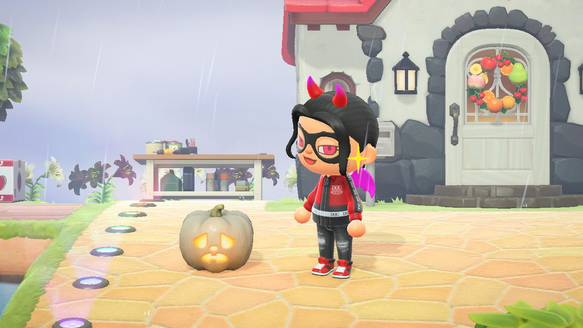 An Animal Crossing character with horns and wings smirks near a scared jack-o-lantern