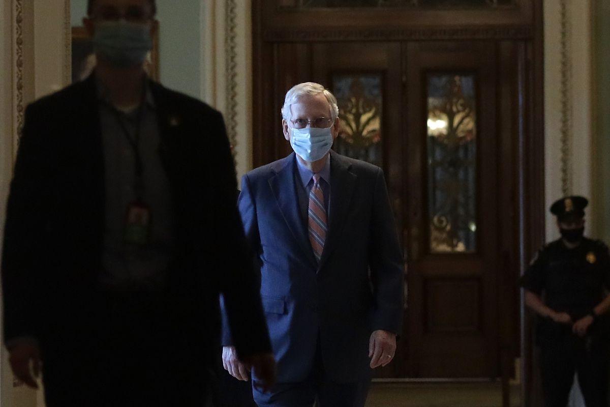 Sen. Mitch McConnell walks through the hallway of the Senate.