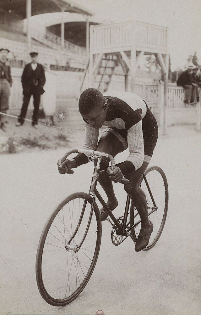 """Marshall """"Major"""" Taylor competes in a 1901 French cycling event, captured by sports photographer Jules Beau."""