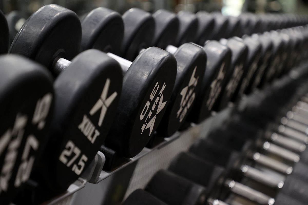A large rack of dumbbells at Gold's Gym Islip in New York