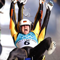 Germany's Patric-Fritz Leitner and Alexander Resch celebrate their gold medal in the doubles luge on Feb. 15, 2002.