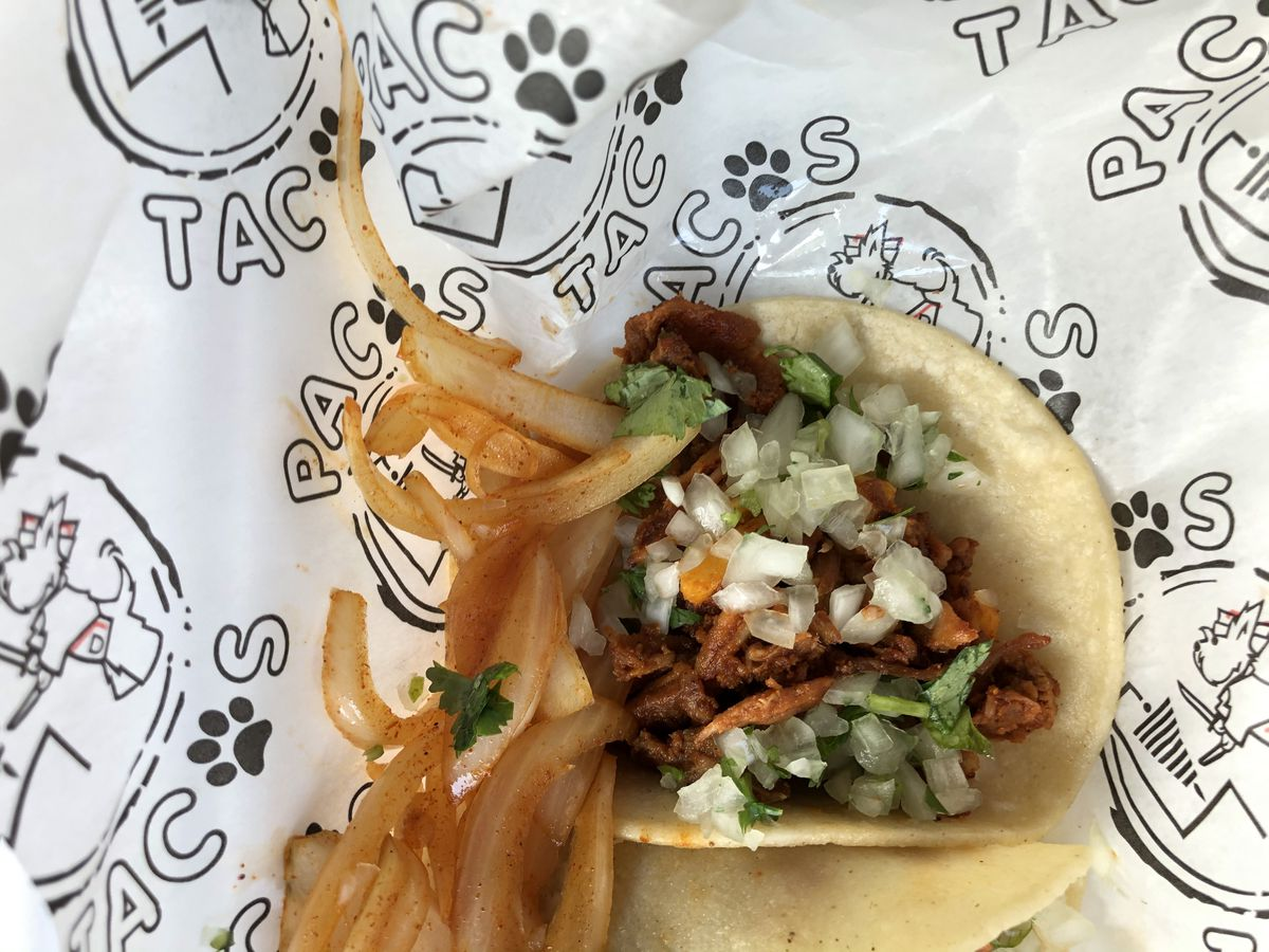 Al pastor tacos cut from a trompo at Pacos Tacos